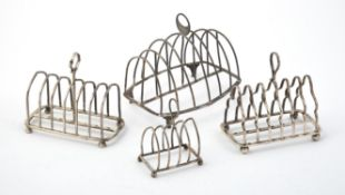 A George III silver barrel shaped six division toast rack by Mary Troby