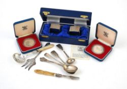 Y A cased pair of silver shaped square napkin rings by Adie Bros Ltd.