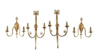 A pair of gilt metal twin light wall appliques in late 18th century taste