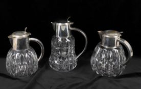 Three similar silver plate mounted glass lemonade jugs