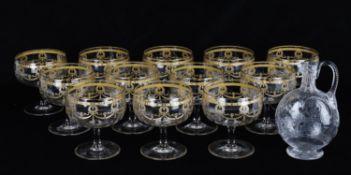 A set of twelve 20th Century large engraved gilt goblets/gin glasses