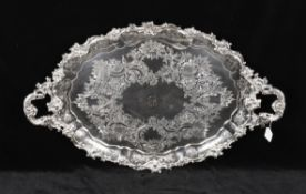 A large silver plated twin handled tray
