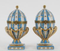 A pair of 20th century continental porcelain and gilt metal mounted ovoid caskets