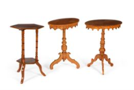 A group of three birch occasional tables