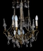 A moulded glass and gilt metal mounted seven light chandelier in George III style