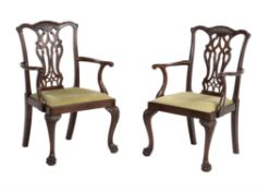 A pair of mahogany open arm chairs in George III style