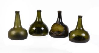 A selection of four English green-glass wine bottles