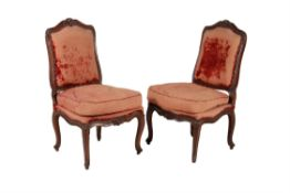 A pair of Louis XV walnut and velvet upholstered side chairs