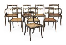 A Set of eight Regency ebonised and parcel gilt dining chairs