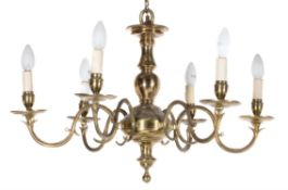 A North European or English brass six light chandelier