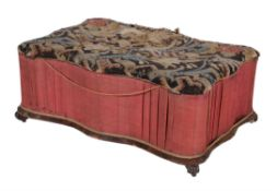 Y An early Victorian rosewood veneered and upholstered ottoman