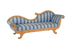 A Northern European satin birch chaise lounge
