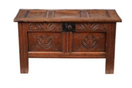 A panelled oak chest or coffer