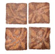 A set of four encaustic decorated floor tiles