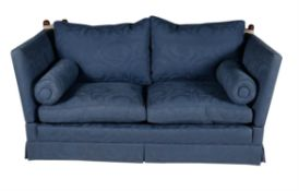 A blue upholstered knole sofa