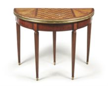 A French walnut and mahogany games table