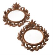 A pair of small giltwood and composition wall mirrors