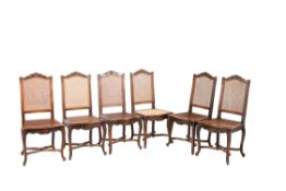 A set of six French carved beech and cane panel inset dining chairs
