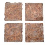 A set of four encaustic decorated tiles