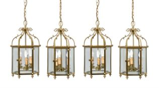 A set of four gilt metal and glazed hexagonal hall lanterns