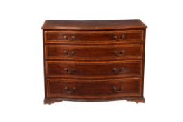 A mahogany and marquetry inlaid serpentine fronted chest of drawers