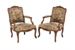 A pair of Louis XV walnut and beechwood armchairs