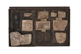 A framed collection of plaster casts of Early Modern printing blocks