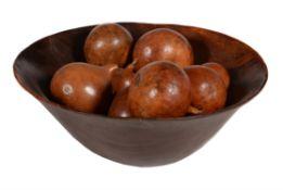A turned fruit wood fruit bowl