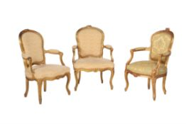 A pair of giltwood and upholstered armchairs in Louis XV style