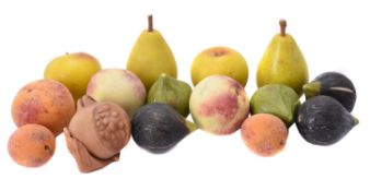 A collection of fourteen models of fruit