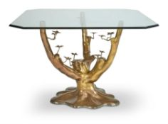 A GILT METAL AND GLASS DINING TABLE, MANNER OF JACQUES DUVAL-BRASSEUR