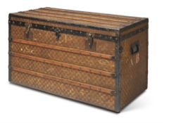A FRENCH CANVAS AND WOODEN BOUND TRUNK, BY BIGOT