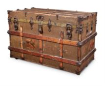 A CANVAS, WOOD AND METAL BOUND TRAVELLING TRUNK