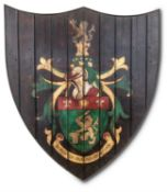 A STAINED PINE PAINTED ARMORIAL PANEL, MODERN