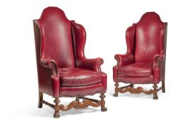 A PAIR OF VICTORIAN WALNUT AND RED LEATHER UPHOLSTERED WING ARMCHAIRS