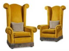 A PAIR OF YELLOW UPHOLSTERED 'CASTLE CHAIRS', BY A MODERN GRAND TOUR