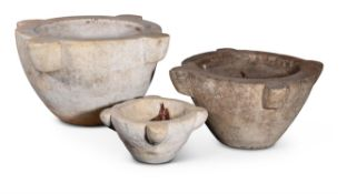 A GROUP OF THREE SIMILAR PESTLE AND MORTARS