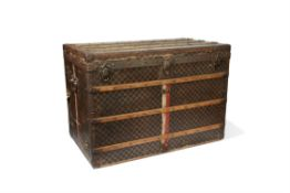 A LOUIS VUITTON CANVAS AND WOODEN BOUND TRUNK