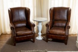 A PAIR OF LEATHER WING BACK CHAIRS, 20TH CENTURY