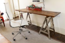 A PLANKED OAK AND CHROME TRESTLE DESK, MODERN