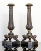 A PAIR OF GILT BRASS CANDLESTICKS IN GOTHIC REVIVAL TASTE19TH CENTURY