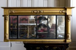 A GEORGE IV GILTWOOD AND COMPOSITION TRIPTYCH WALL MIRROR, CIRCA 1830