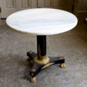 AN EBONISED GILT METAL MOUNTED AND MARBLE TOPPED CENTRE TABLE IN REGENCY STYLE