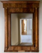 A CONTINENTAL WALNUT WALL MIRROR, 19TH CENTURY