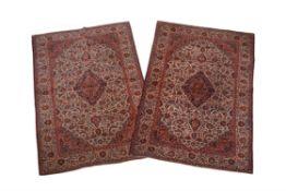 A pair of Kashan rugs
