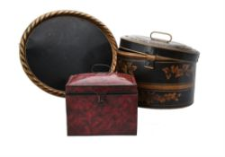 A Regency and black and parcel gilt painted tinware hat box