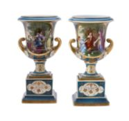 A pair of blue ground and gilt Vienna style Campana urns on plinth bases