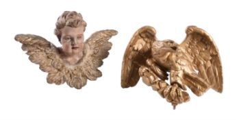 A Continental polychrome painted and parcel giltwood model of a putto
