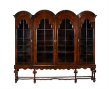 A pair of walnut bookcase cabinets in Queen Anne style