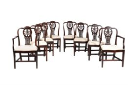 A set of eight mahogany dining chairs in George III style